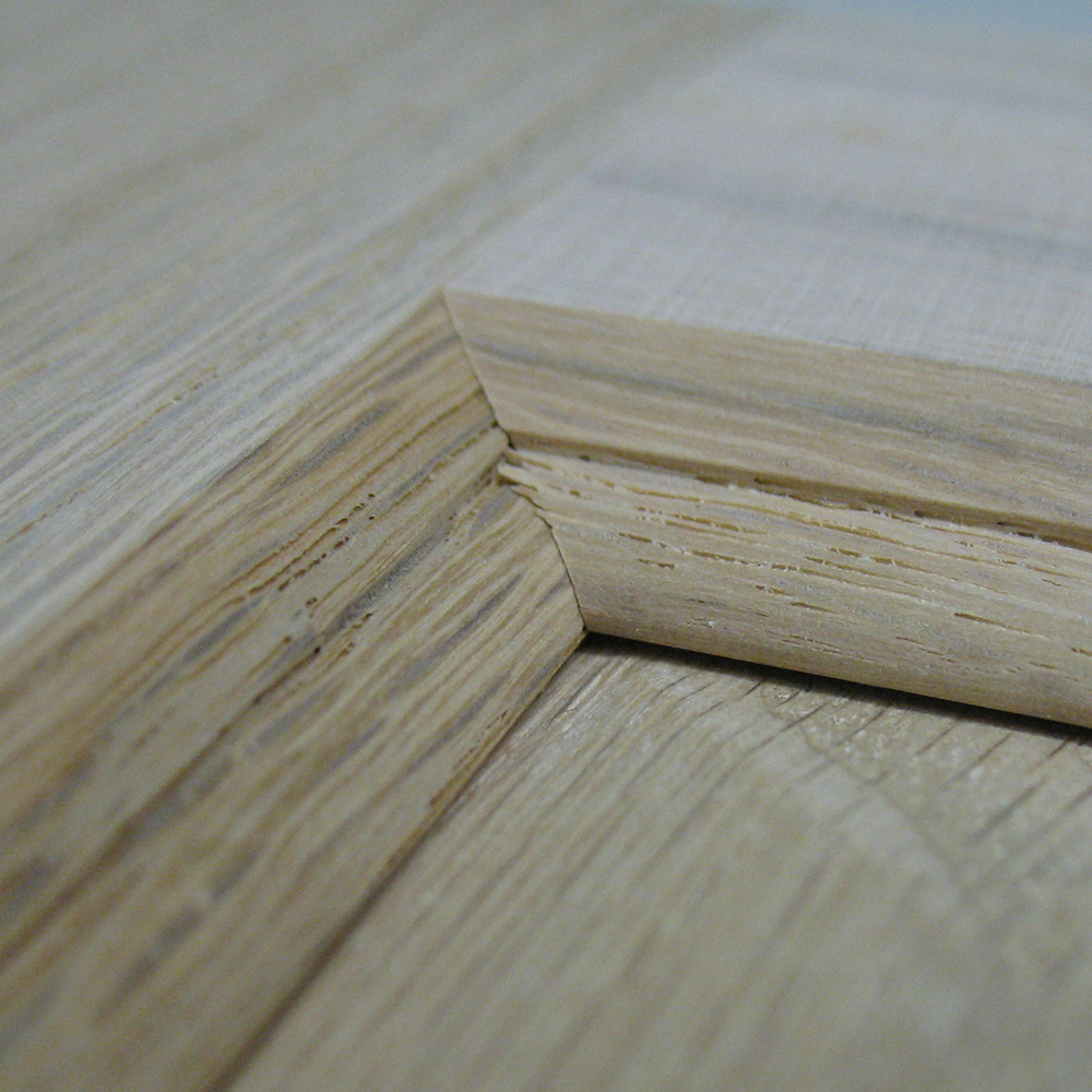 Detailed view of a mitered corner of a cabinet door